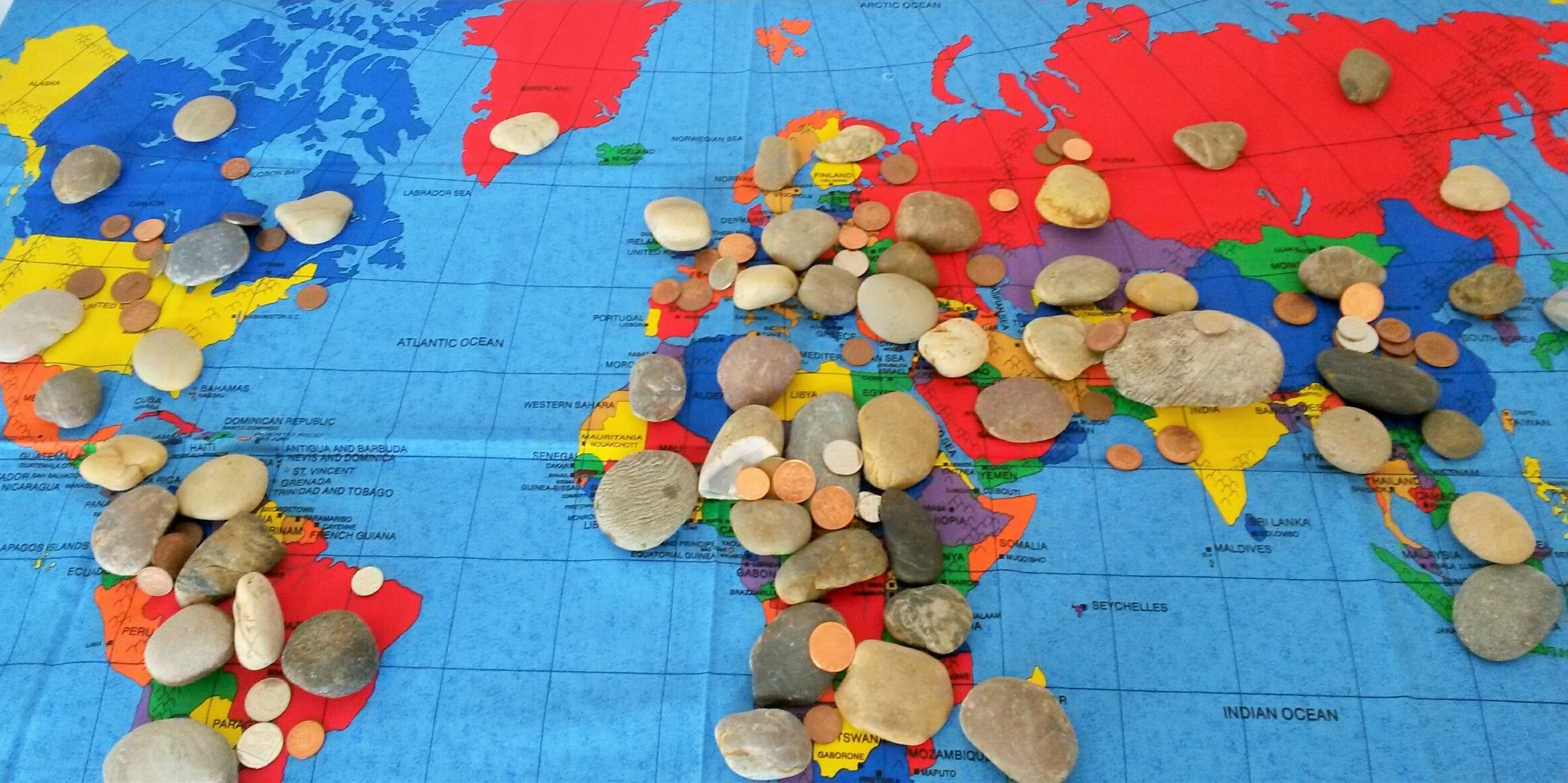 Map burdened symbolically with stones and coins